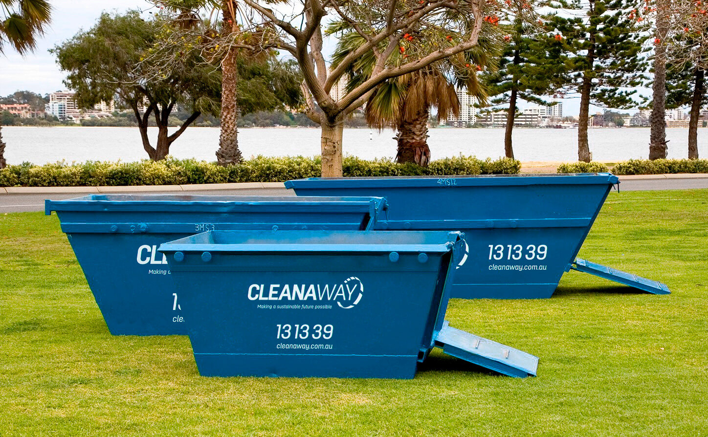 Cleanaway skip bins on grass