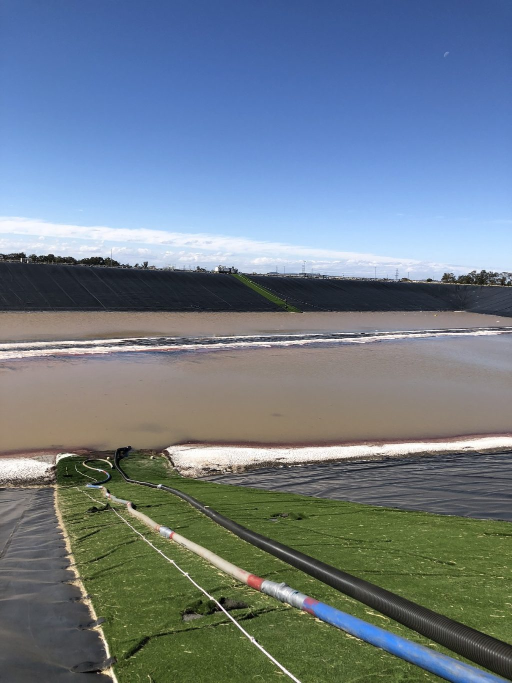 removing large amount of brine water from a pond