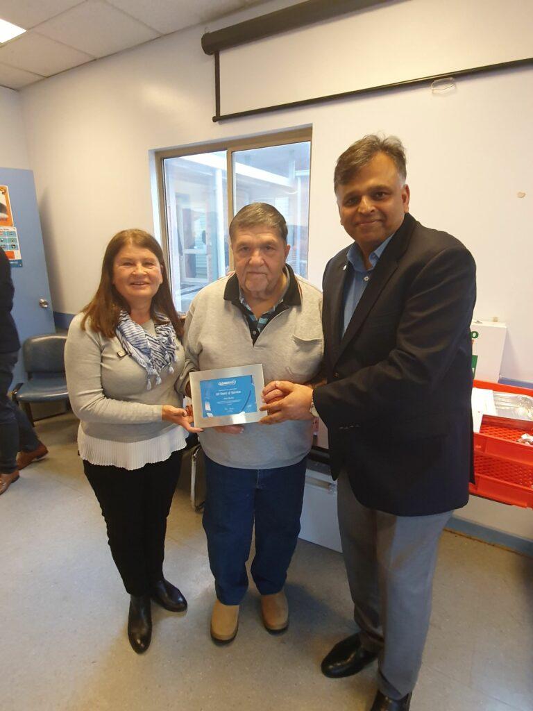 Cleanaway CEO Vik Bansal and Alan Burke celebrating 50 years