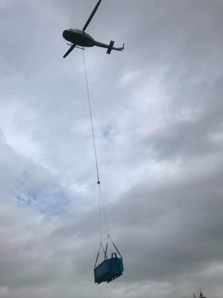 helicopter carrying a bin