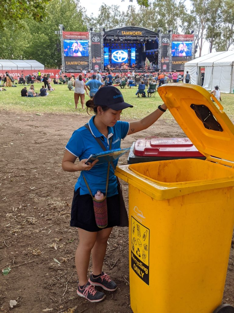 Resource Recovery Officer Evelyn doing a visual audit of a recycling bin to check for contamination
