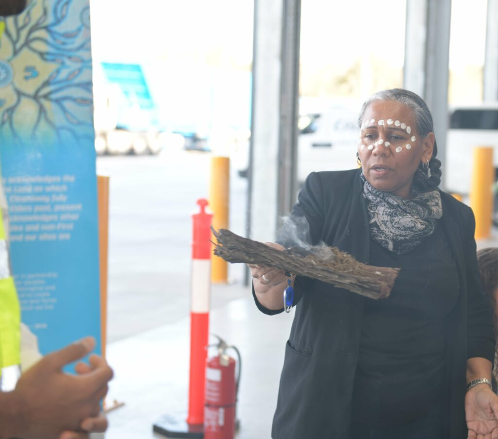 Louisa Bonner performing a smoking ritual as part of a Welcome to Country, Smoking Ceremony