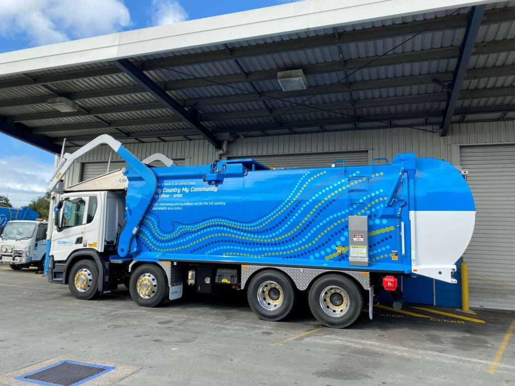 My Country My Community artwork featured on a Cleanaway frontlift truck